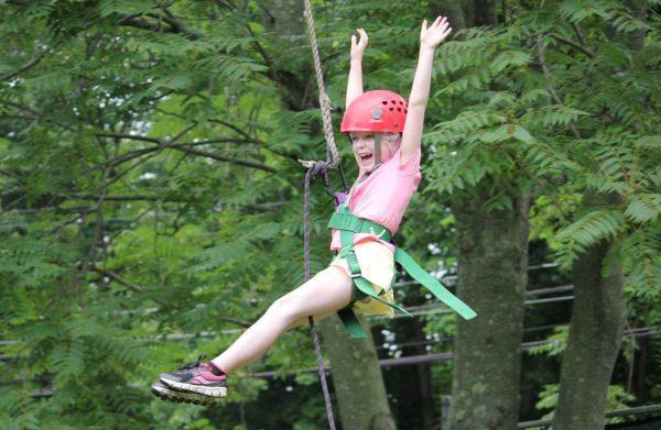 Camper Girl Happy on a Zip Line Cheering