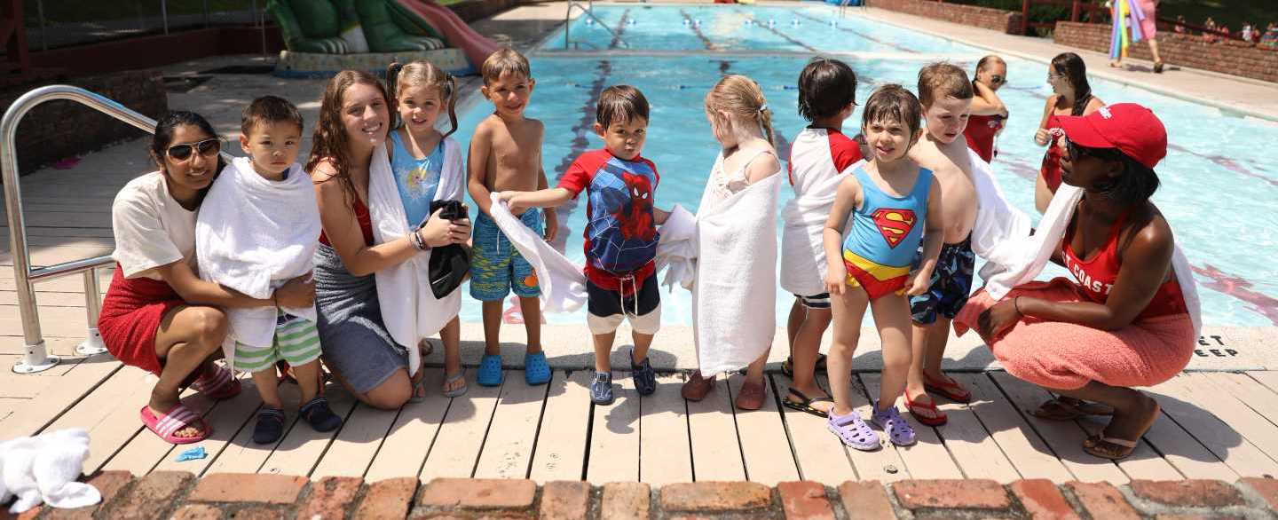 Toddler Campers Posing in front of the pool with counselors