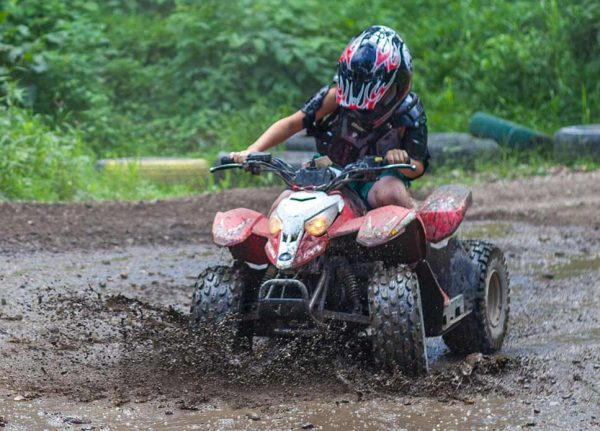 Camper Riding Through the mud on an ATV