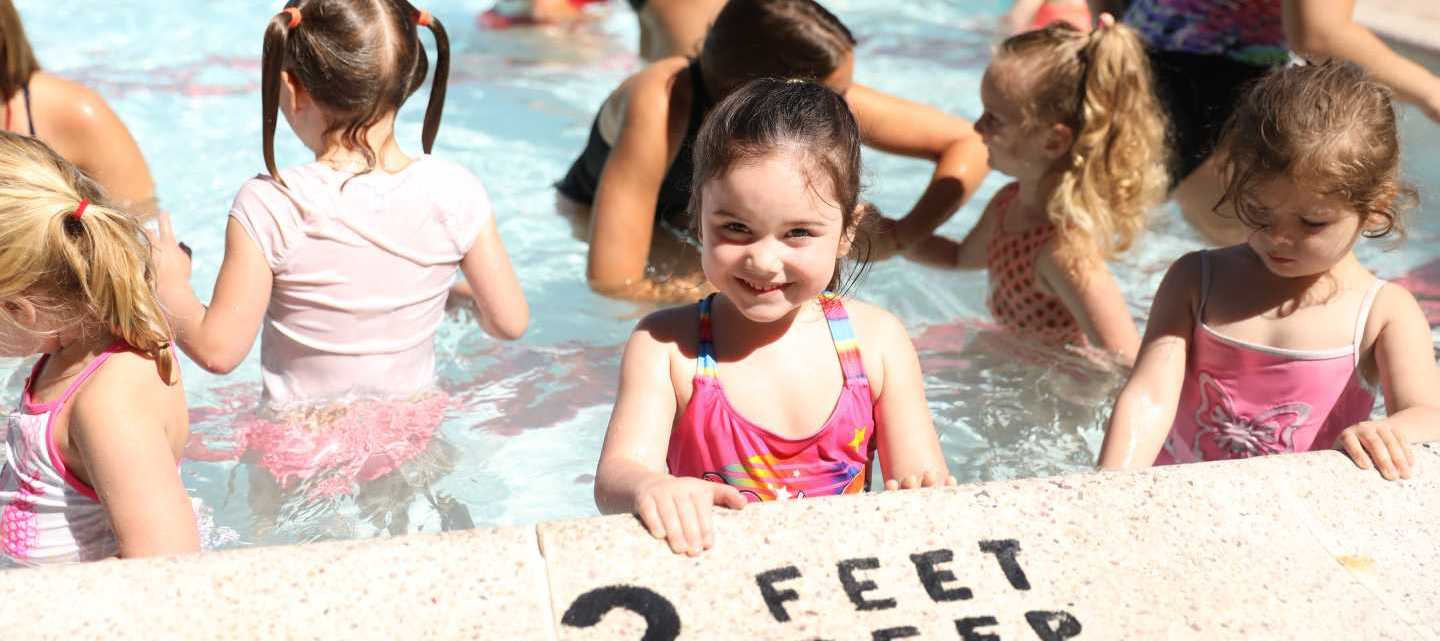 West Hills Day Camp Preschool Camper in the Pool Smiling