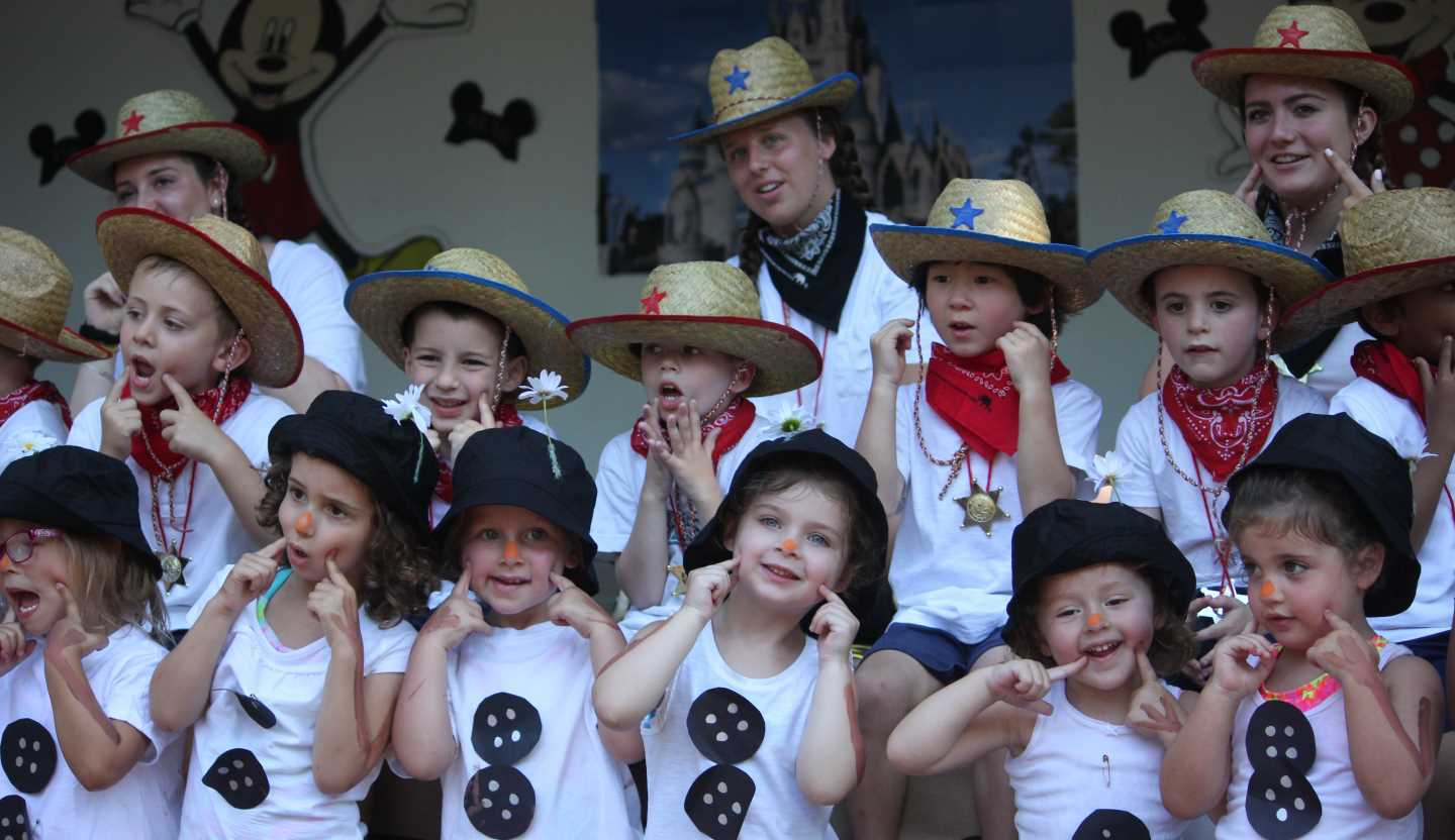 Preschool Campers Dressed up Performing on Stage