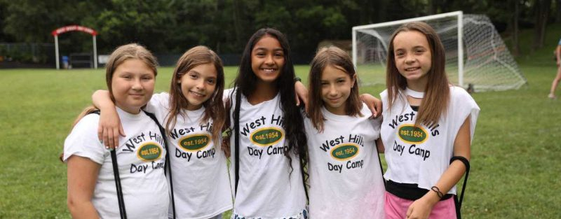 West Hills Day Camp Girl Campers Posing With West Hills Day Camp Shirts
