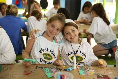 West Hills Day Camp Camper Girls Posing at Arts and Crafts Smiling