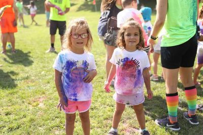 West Hills Day Camp Girls Posing With Colored Powder on their Shirts From Color Battles