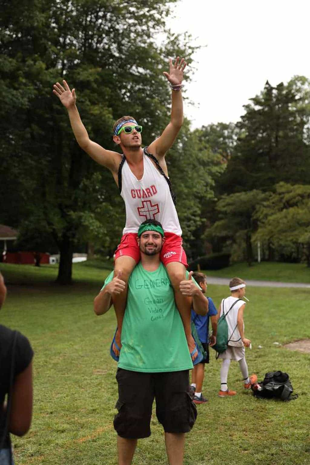 West Hills Day Camp Counselors Sitting on Each other's Shoulders Cheering