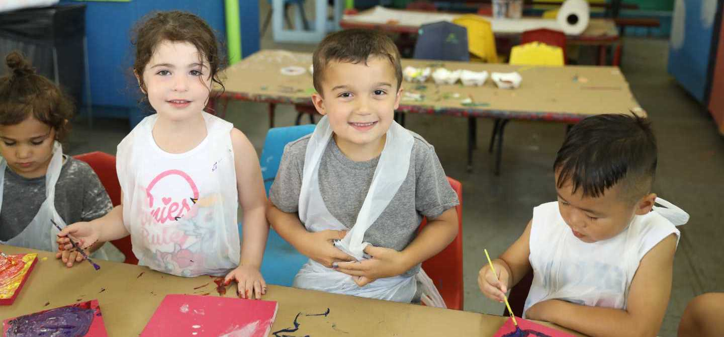 Young Campers Doing Arts and Crafts Painting
