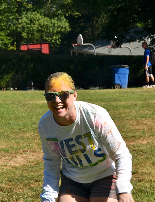Kim Doxey, West Hills Director Covered in Neon Dust Laughing During Color Run